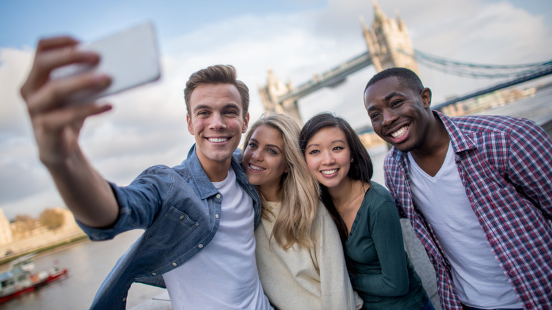 Group of friends taking a selfie in London